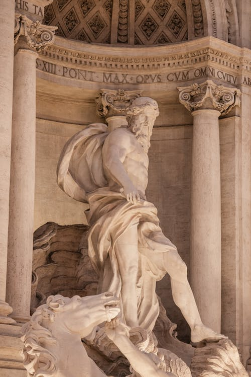 Statue in central niche of Trevi Fountain in Rome