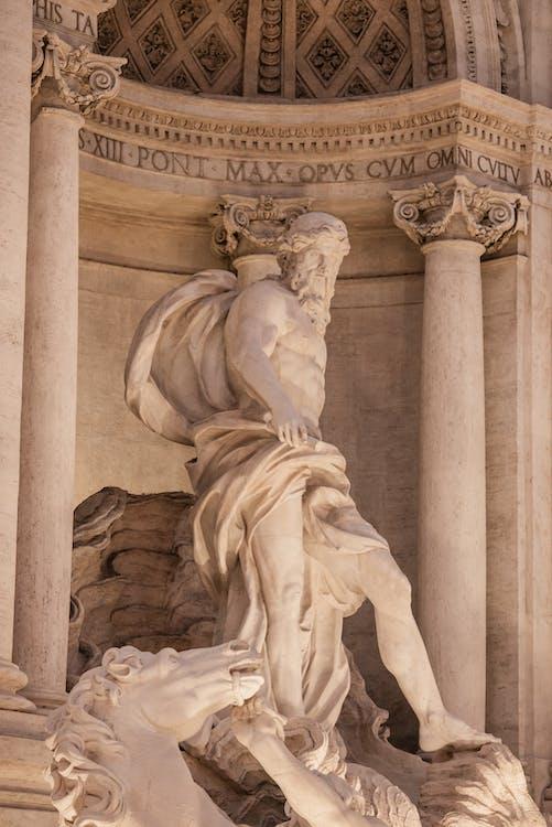 Statue in central niche of Trevi Fountain in Rome