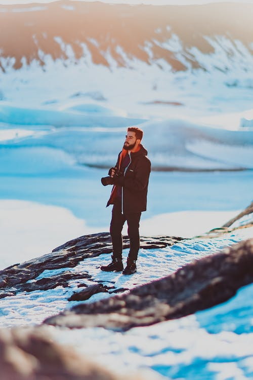 Photographer on snowy mountain edge