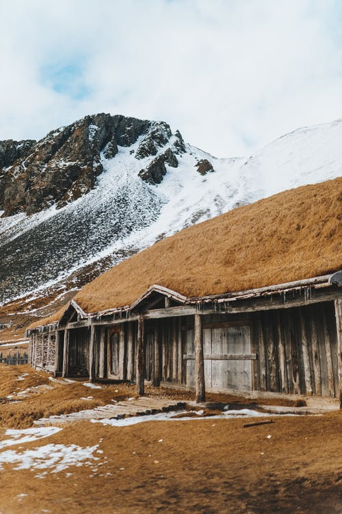 Shabby wooden hut in cold mountains