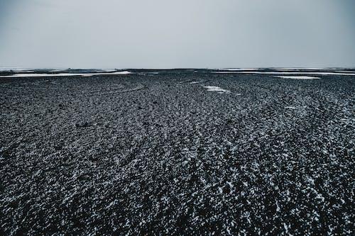 Uneven endless ground under white sky in winter
