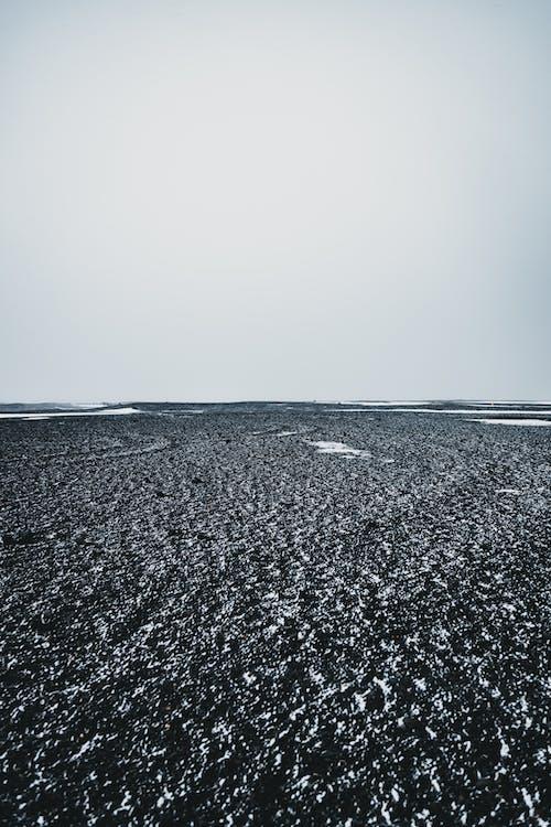 Rough terrain with horizon under sky in winter