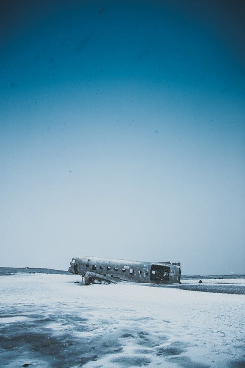 Abandoned plane after accident on snowy land