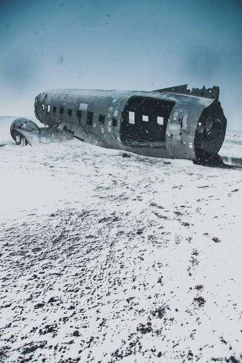 Wrecked Airplane on Snow Covered Ground