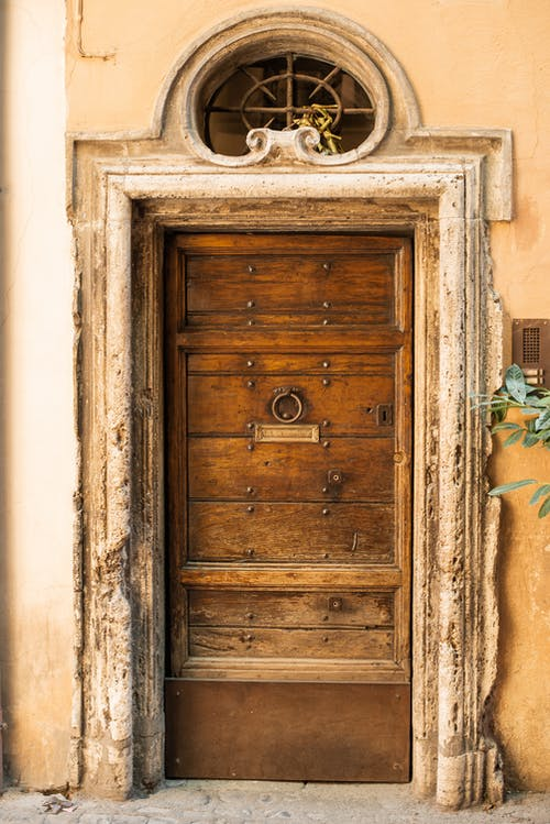 Shabby wooden door of old stone house