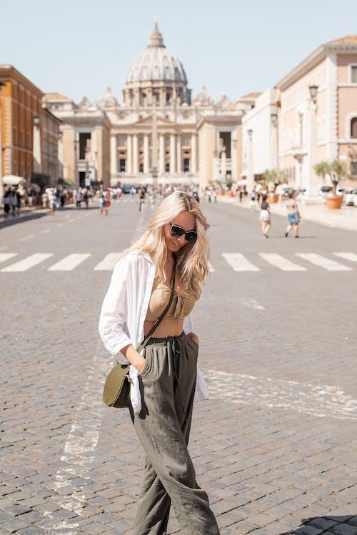 Stylish woman walking along street in Rome