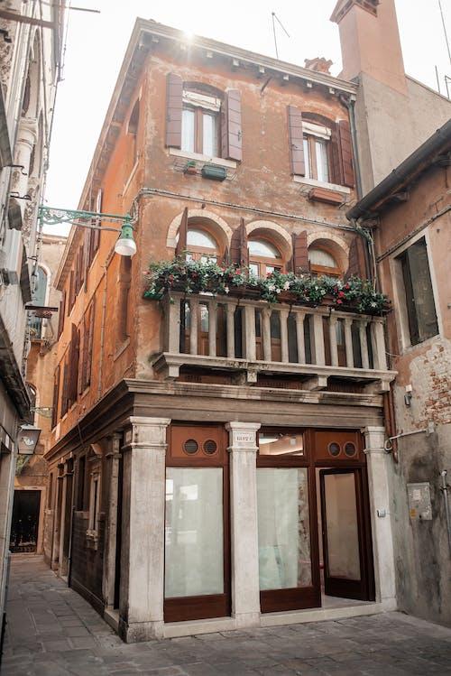 Facade of old building with cozy balcony
