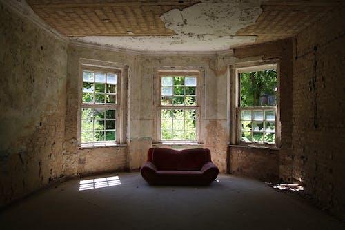 A Red Leather Sofa Near Window