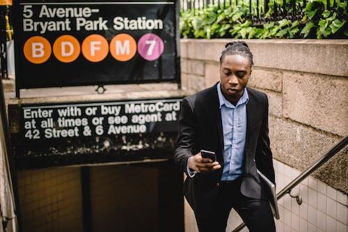 Gratis stockfoto met Afro-Amerikaans, amerika, apparaat, apparaatje