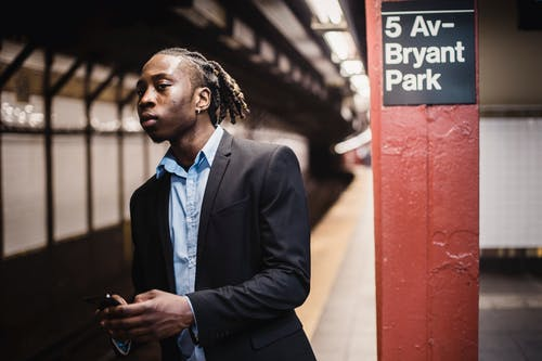 Serious young male waiting for train in New York underground