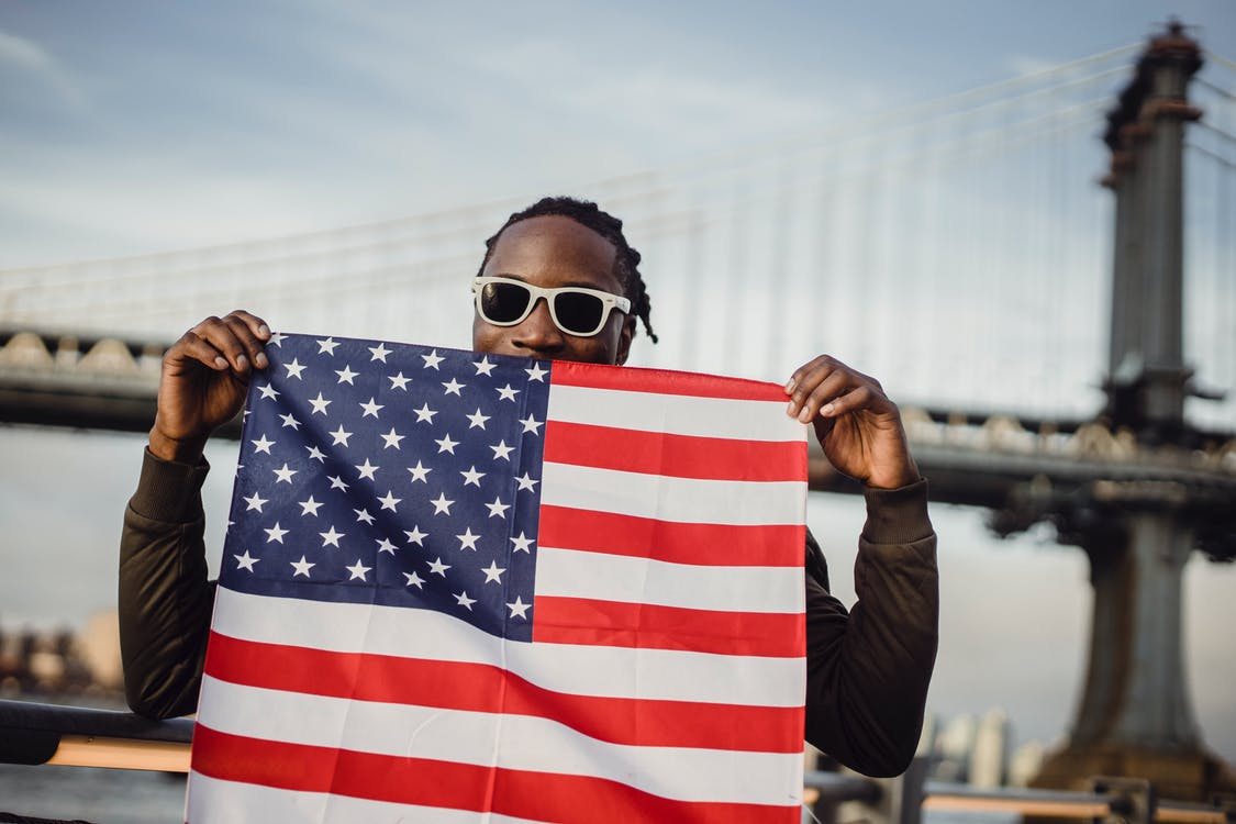 Friendly man with US flag kerchief in hands