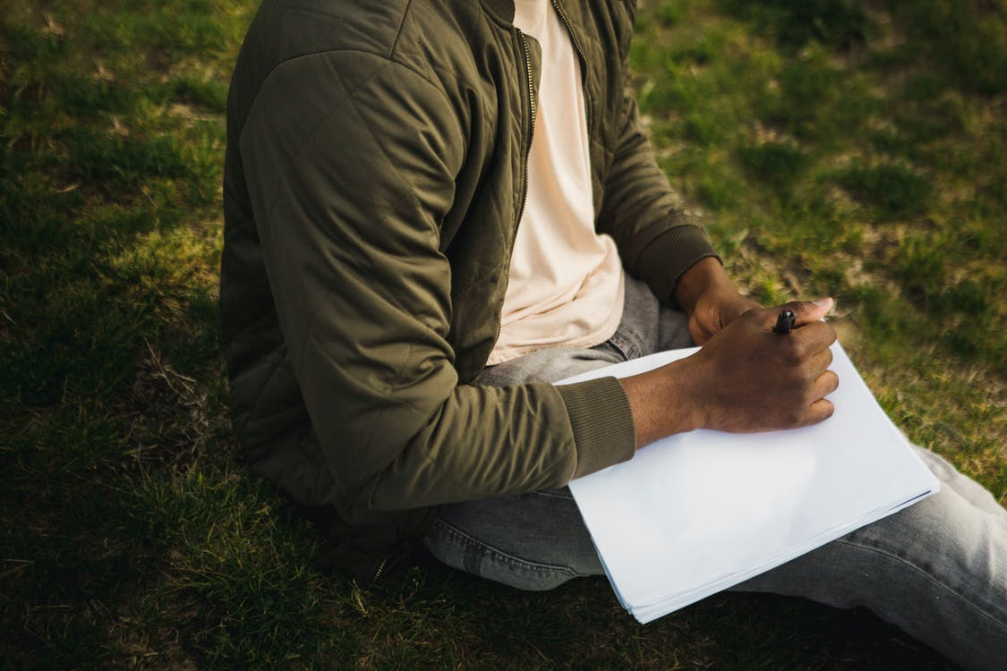 Crop artist with new sketchpad in park