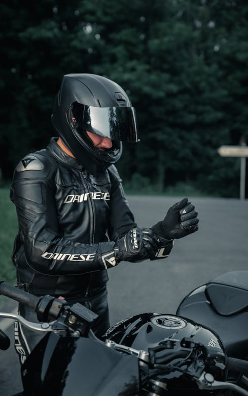 Man in Black Leather Jacket Riding Motorcycle