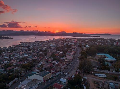 City Skyline during Sunset Under Orange Sky