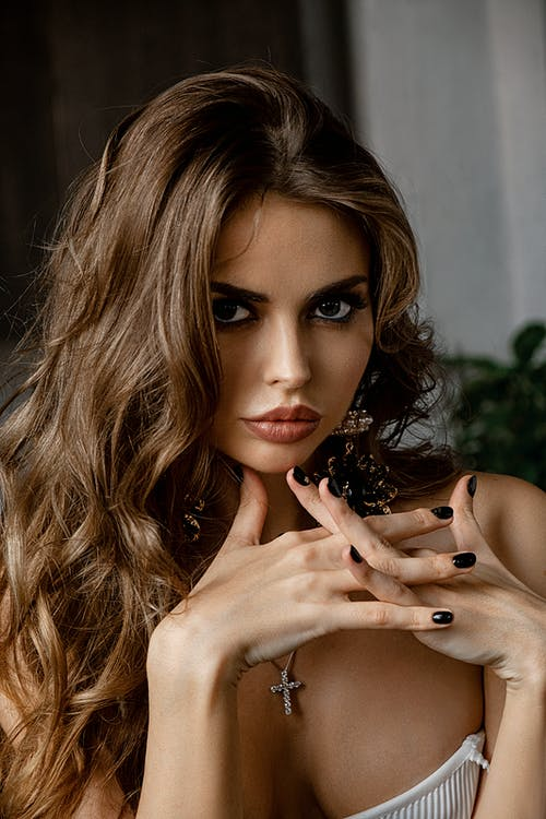 Sensual young woman looking at camera
