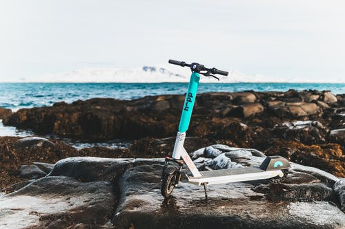 Blue and White Bicycle on Gray Rock Formation