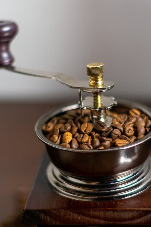 Stainless Steel Spoon on Brown Ceramic Bowl