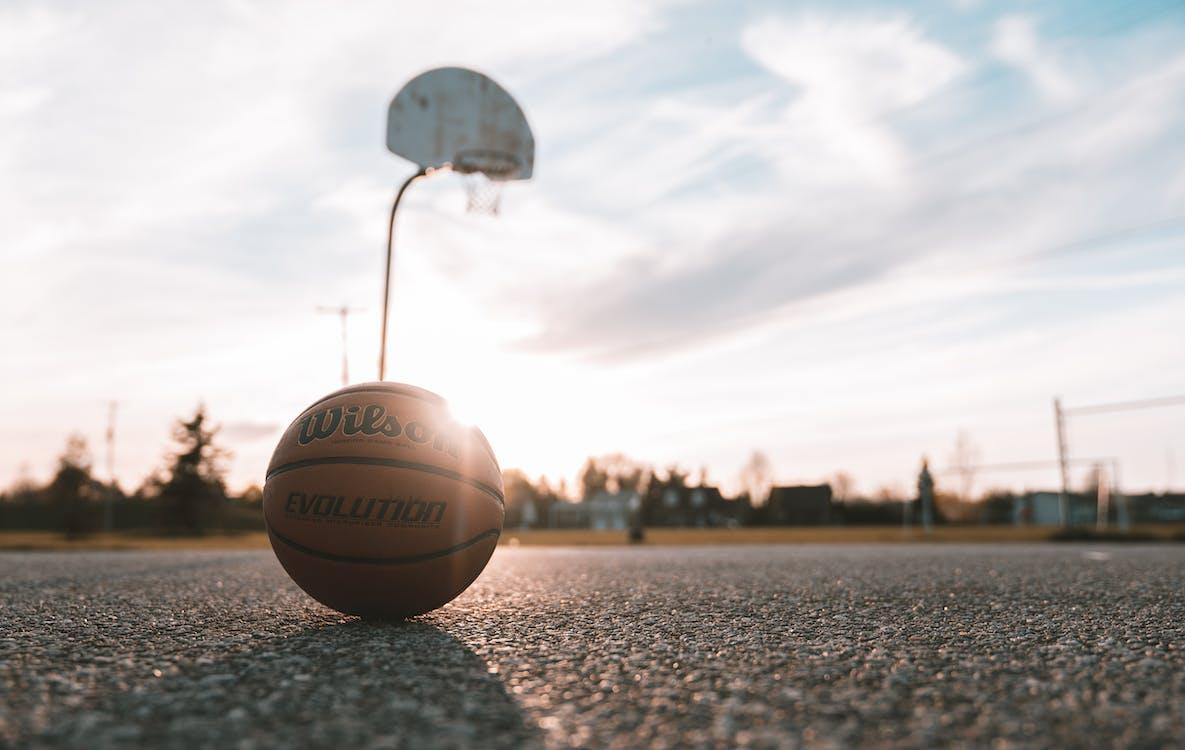 White Basketball on Gray Asphalt Road