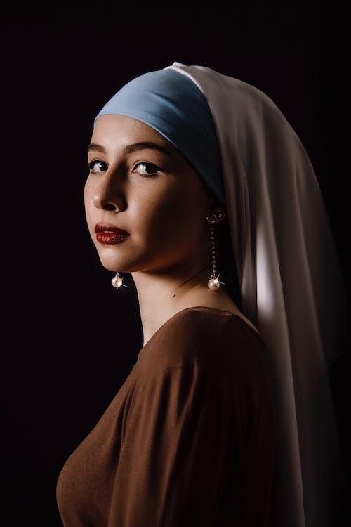 Woman in Brown Dress Wearing Blue Hijab