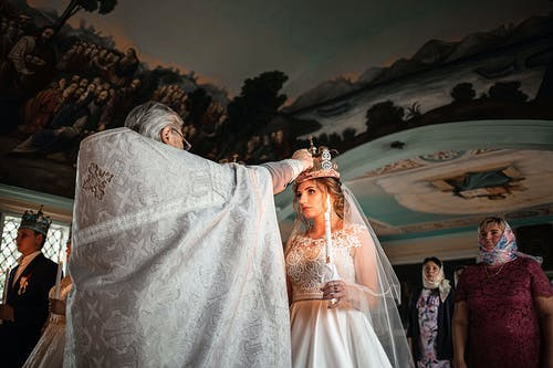 Priest performing wedding ceremony in church