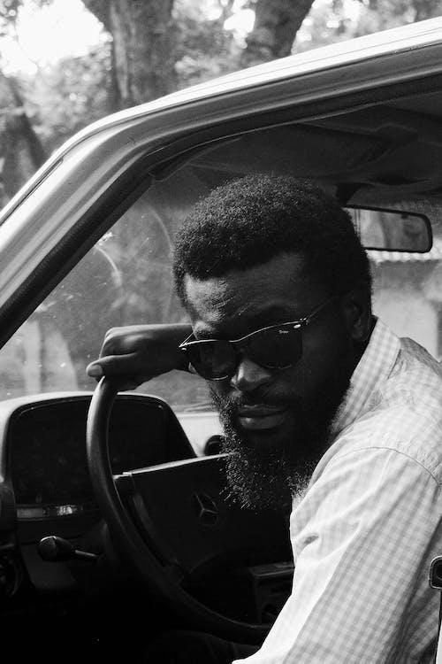 Bearded black man in car