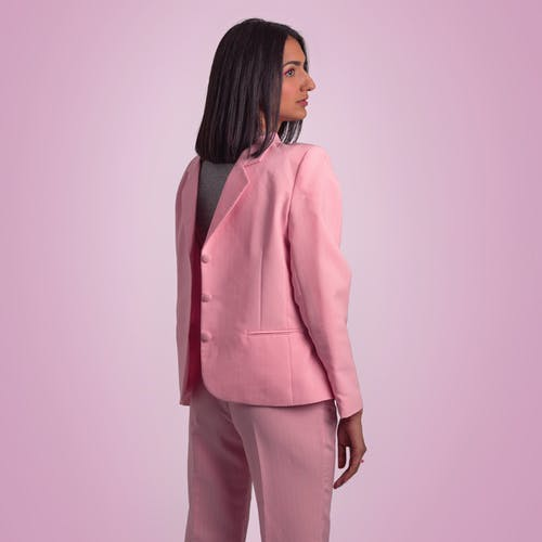 Stylish woman in pink suit