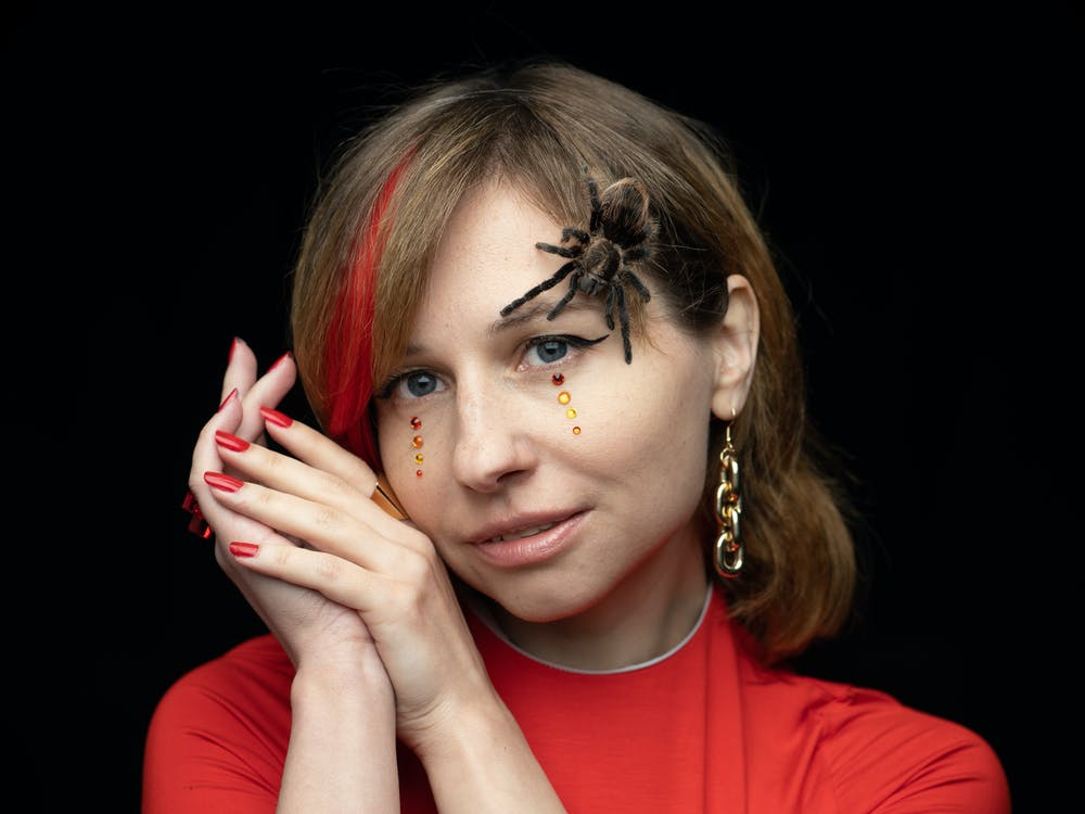 Brave female with spider on face