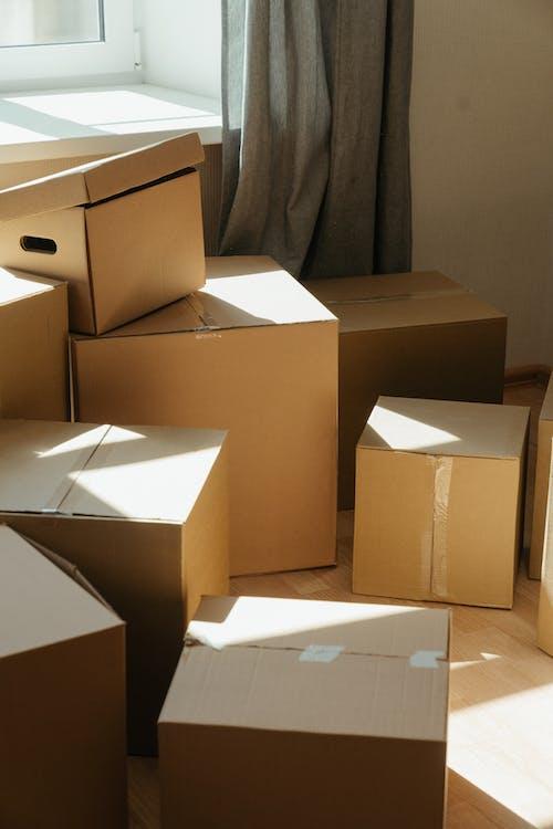 Brown Cardboard Boxes on White Ceramic Tiles