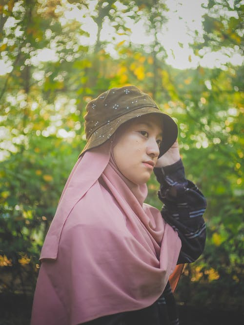 Woman in Pink Hijab and Bucket Hat