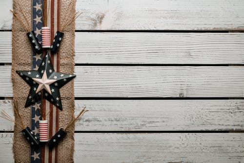 Wooden table decorated with badges and tape with United States flag