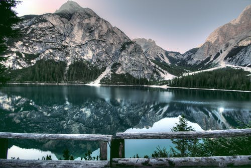 Digital Photography of Mountains and Body of Water