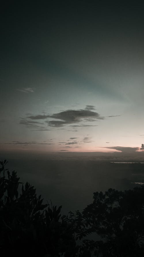 Sun setting over calm mountainous terrain