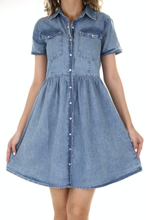 Woman in Blue Denim Button Up Shirt