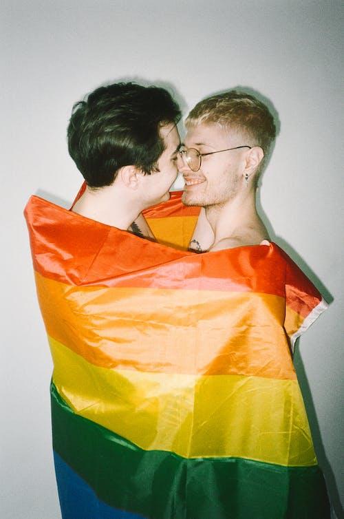Men Wrapped in Gay Pride Flag