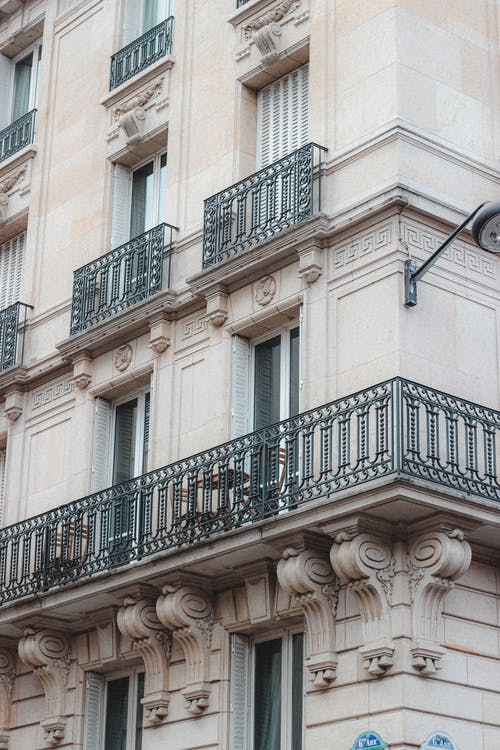 Facade of old residential house with balconies