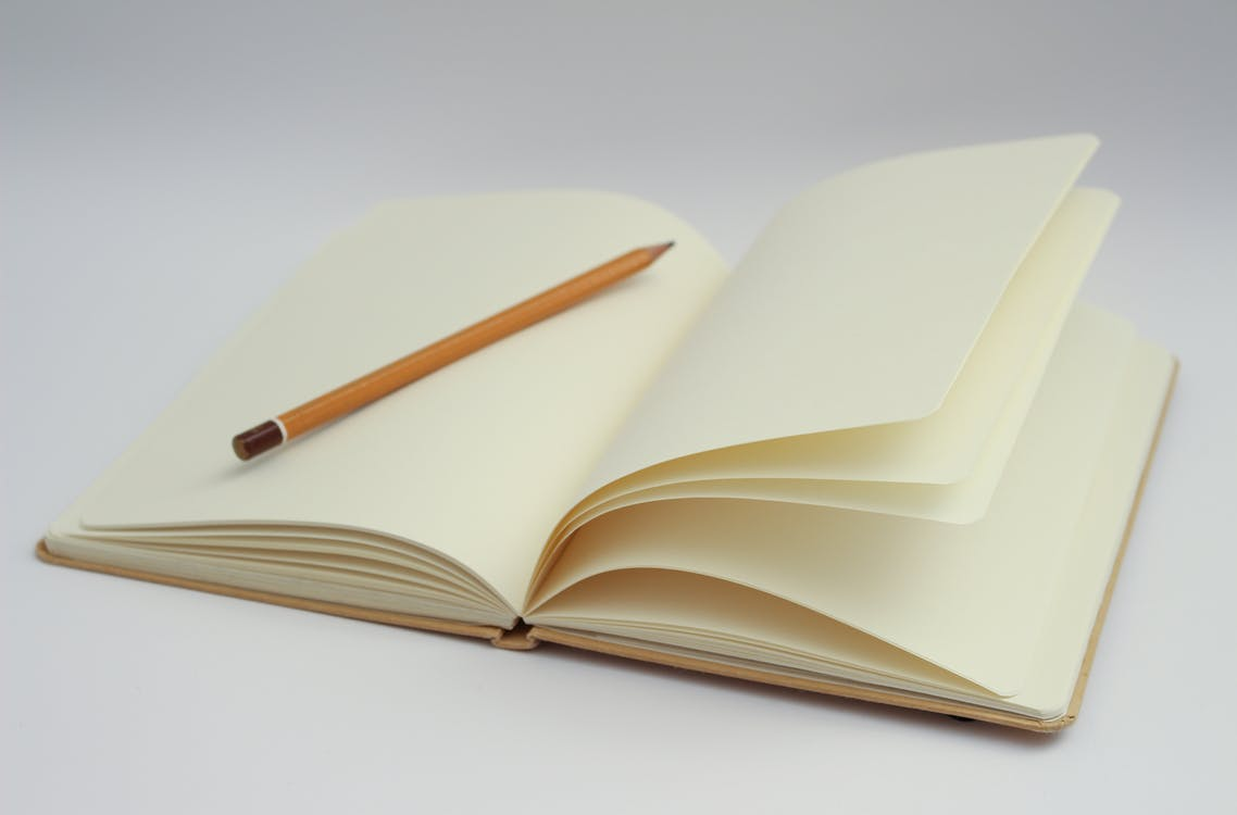 White Notebook and Yellow Pencil