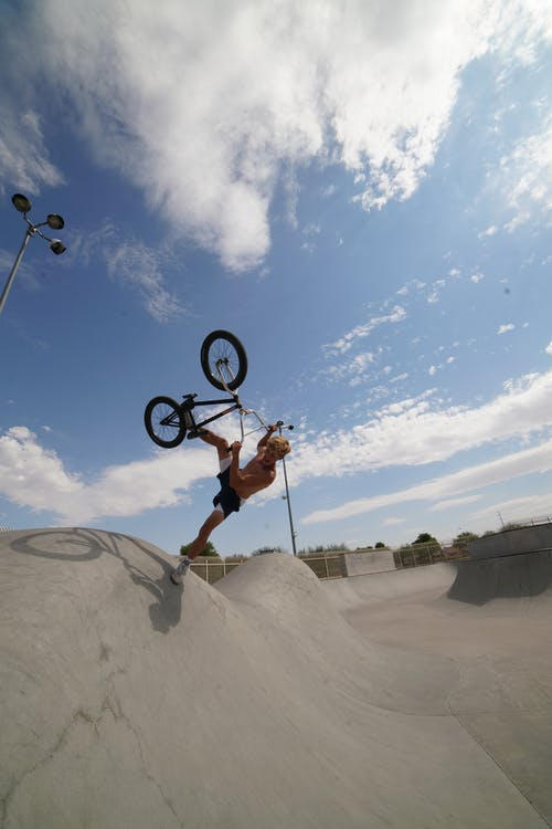 Professional cyclist performing stunt on BMX