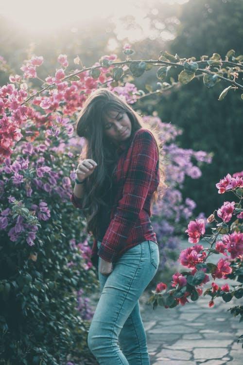 Tender young woman relaxing in garden with closed eyes