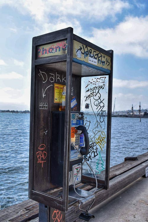 Free stock photo of old school, payphone, spray paint