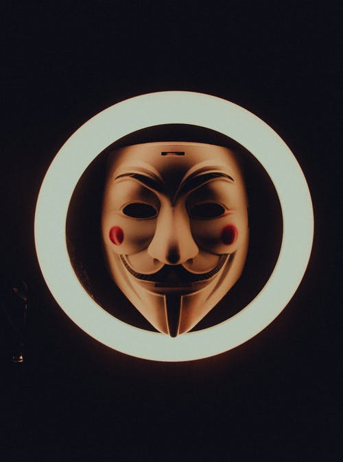 A Guy Fawkes Mask in the Middle of a Ring Light