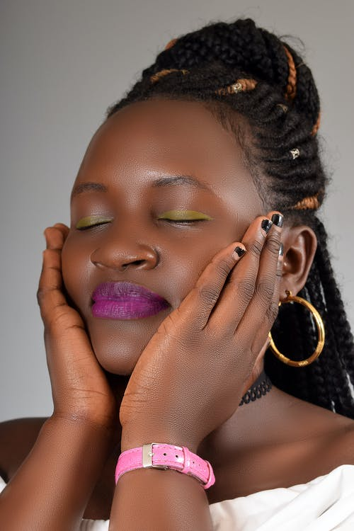 Sensual black female touching pump cheeks