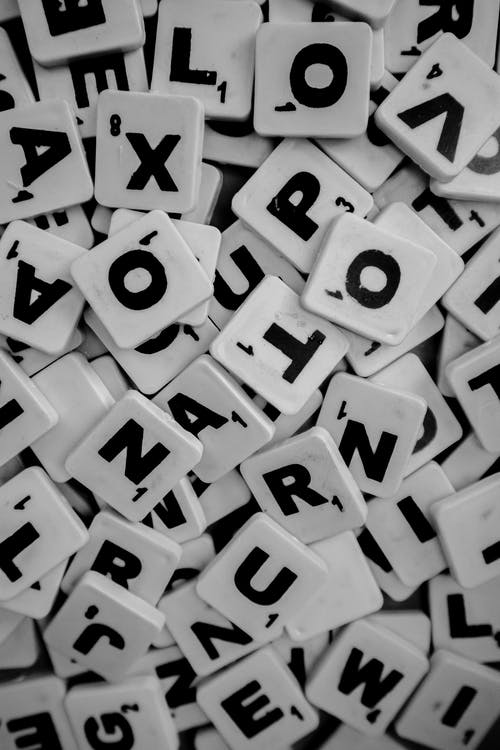 Pile of Scrabble Tiles with Letters