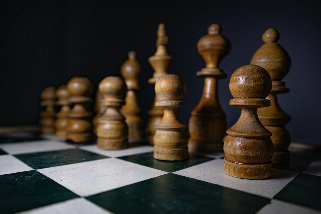 Wooden Chess Pieces on a Chess Board