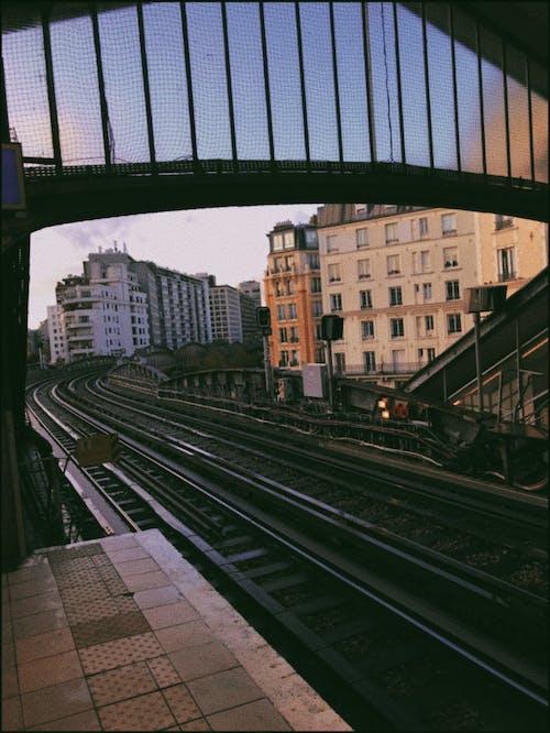 Railways going along high apartment buildings