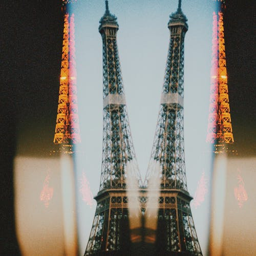 Double exposure of Eiffel Tower recognizable architectural landmark located in Paris and attracting tourist