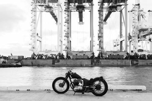 Vintage motorbike on embankment of river