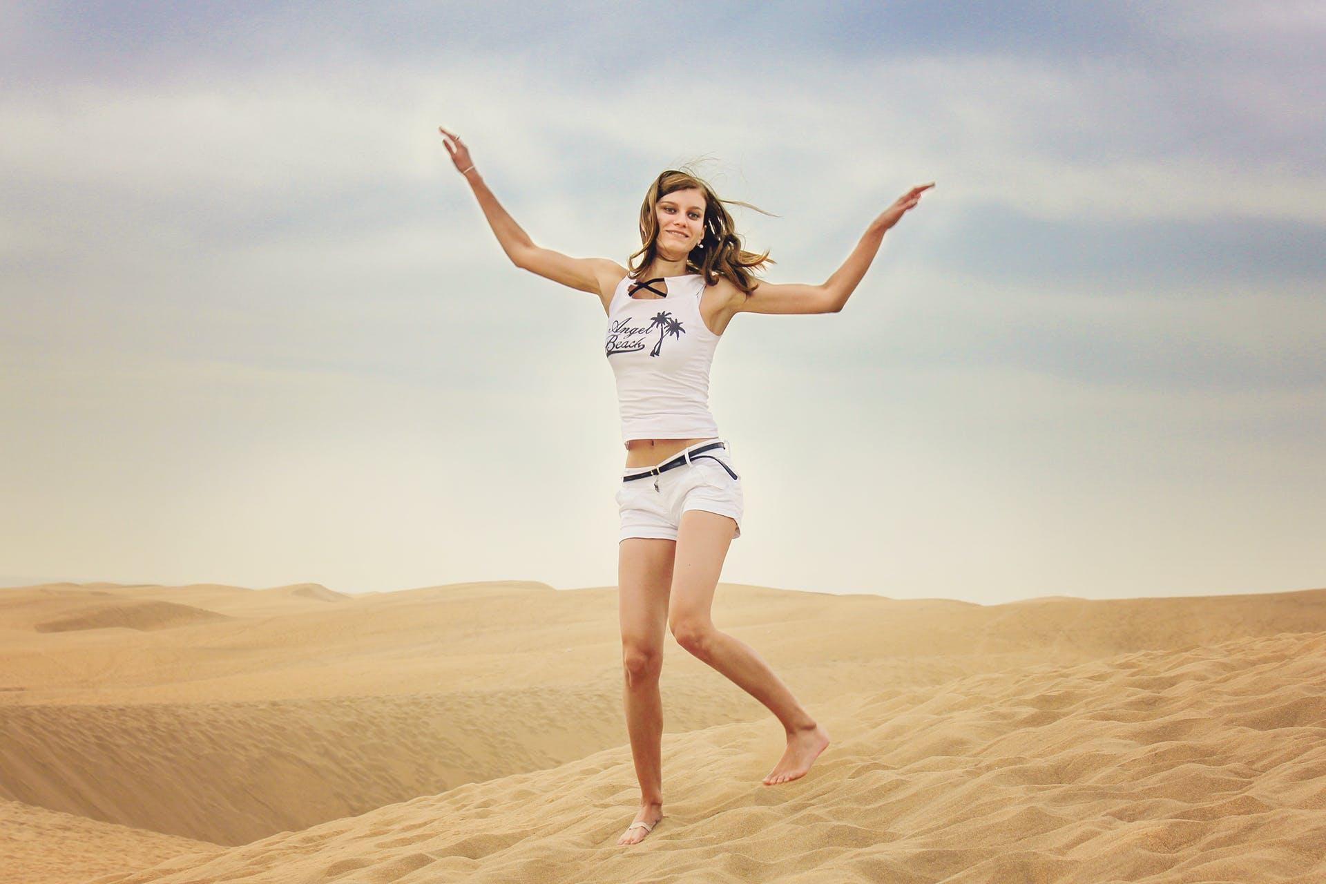 Woman Standing on Desert Sand