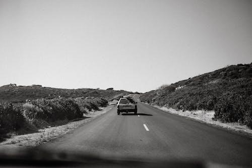 Car riding on asphalt road