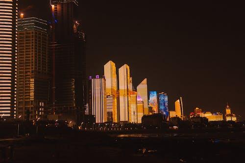 Modern megapolis with illuminated architecture at night