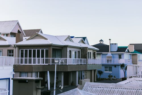 Modern residential house facades under light sky